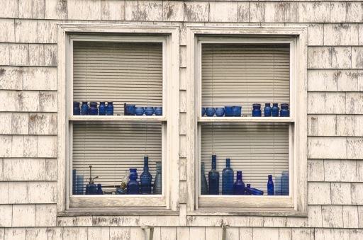blue bottles in windows