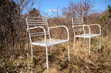 two white metal chairs