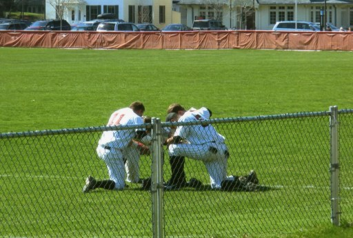 baseball players on bended knee
