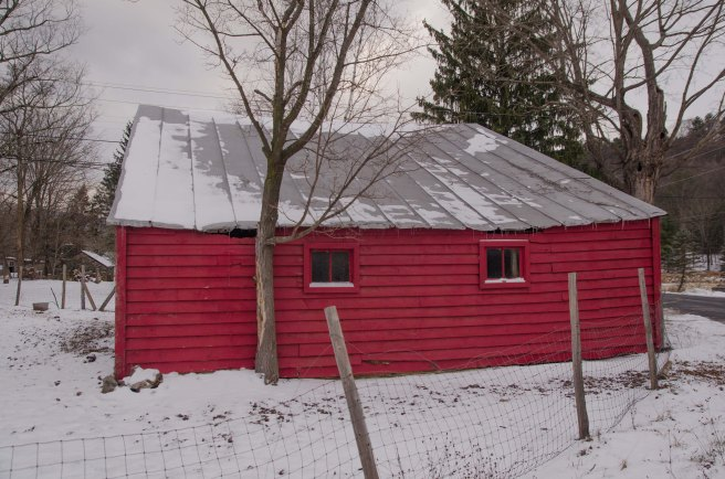 red snow dusted barn